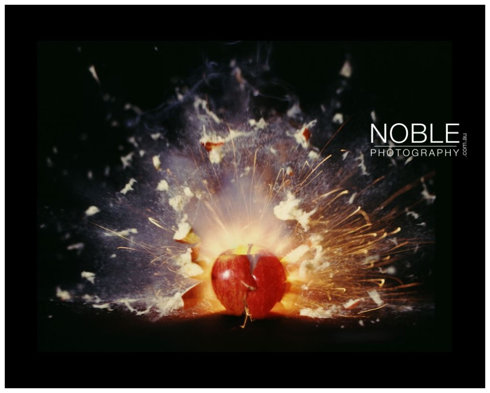 Scientific Photographer Exploding Apple